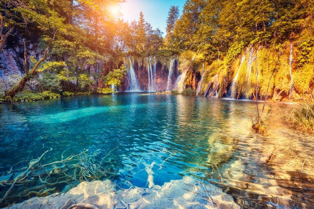 Majestic view on turquoise water and sunny beams in the Plitvice
